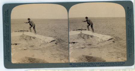 (26) Fisherman at lake turning to cook in a boiling spring the trout just caught, Yellowstone Park, U.S.A.