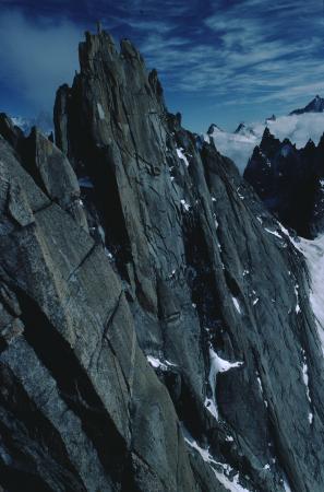 [Riprese varie di vette del Monte Bianco e arrampicata su roccia]