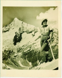 Swiss Mountain Climbing. An attractive girl climber smiles after conquering the Mettelhorn above Zermatt, Switzerland